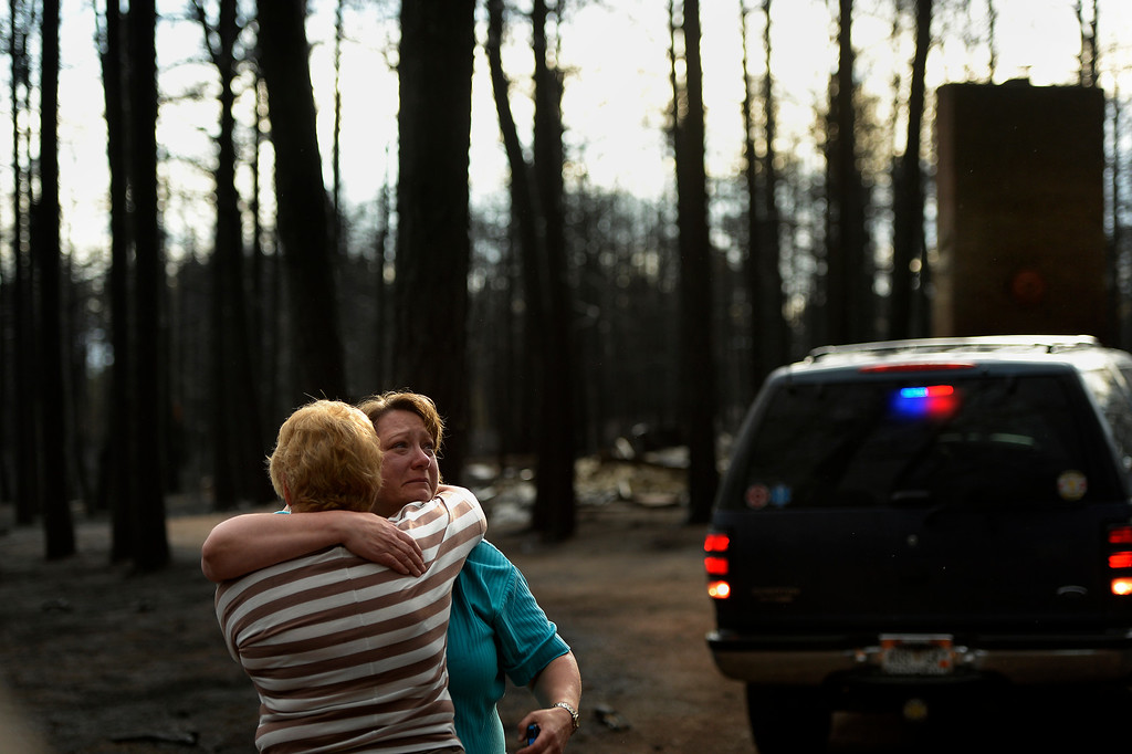 . COLORADO SPRINGS, CO. - June 18: Teresa Robertson breaks down into tears as she is hugged by a neighbor at her home that was totally taken by the fire as some residents were allowed back to see their homes in the Black Forest Fire area near Colorado Springs, Colorado. June 18, 2013 Denver, Colorado Springs. (Photo By Joe Amon/The Denver Post)