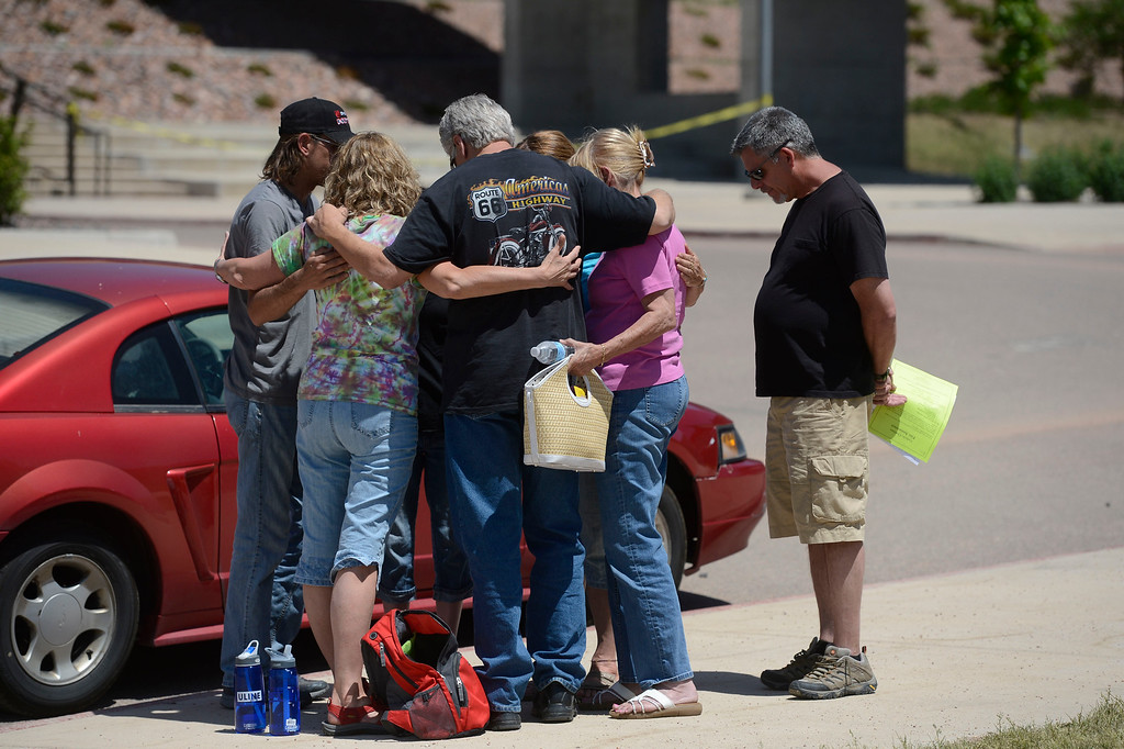 . A group of people in a prayer circle after attending community meeting for current updates on the fire at Palmer Ridge High School in Monument Colorado June 15, 2013. (Photo By Andy Cross/The Denver Post)