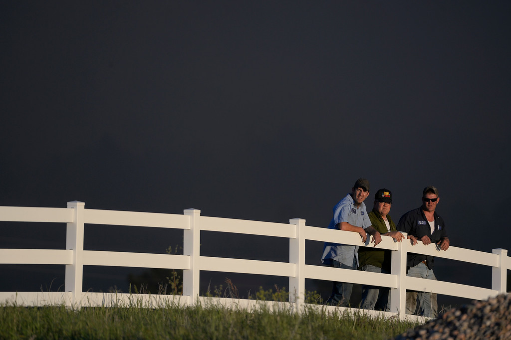 . COLORADO SPRINGS, CO - JUNE 11: Homeowners watch for the advancing fire as they access the danger in the midst of the Black Forest Fire in Colorado Springs, CO on June 11, 2013.. Many homes have already been lost to the raging fire that continues to burn out of control. Photo by Helen H. Richardson/The Denver Post)