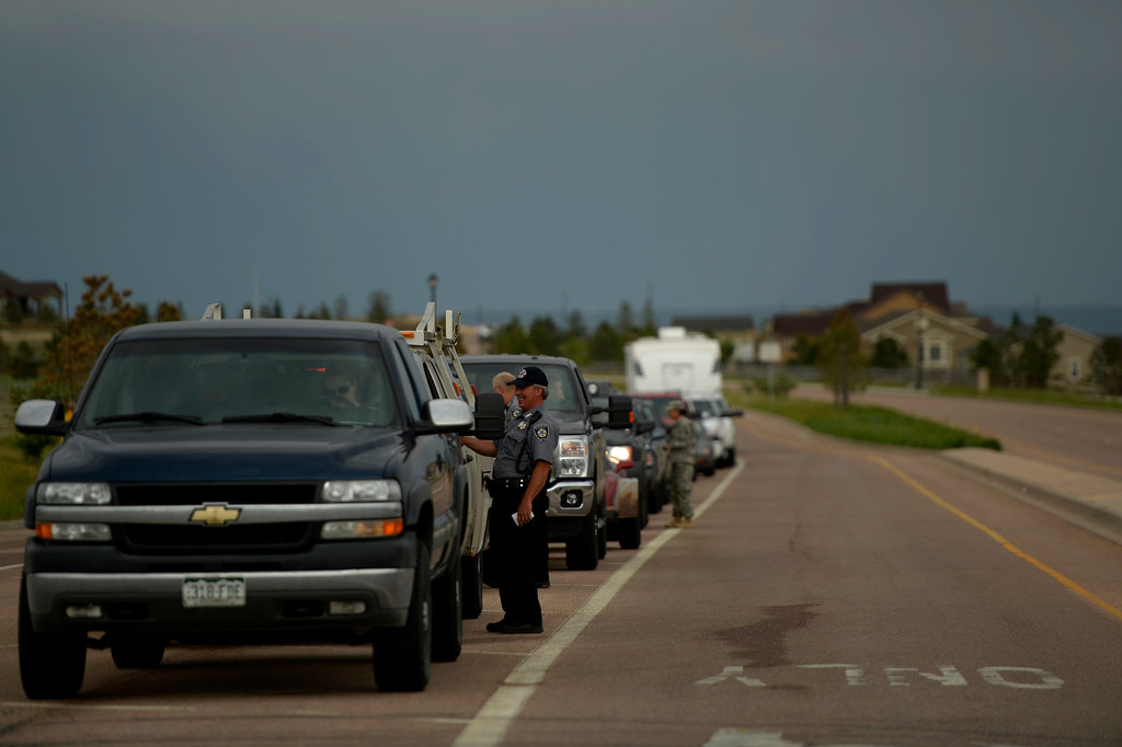 . COLORADO SPRINGS, CO. - June 14: El Paso Sheriffs check ID\'s and get information as some residents were escorted back into the Black Forest Fire area to quickly get medications and important items that were left behind in the rush to evacuate near Colorado Springs, Colorado. June 14, 2013 Denver, Colorado Springs. (Photo By Joe Amon/The Denver Post)