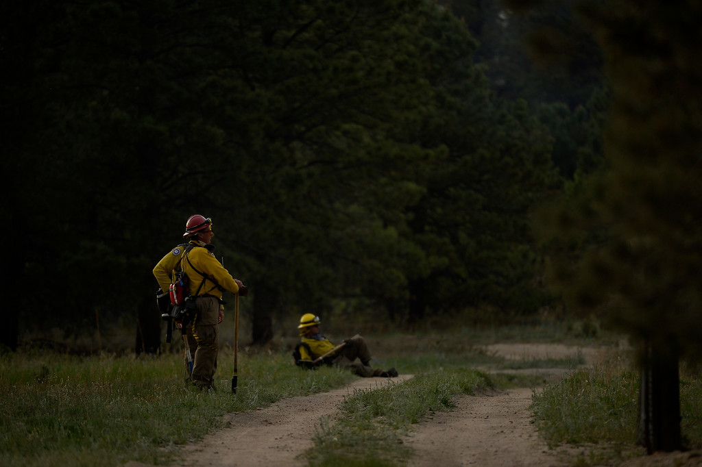 . COLORADO SPRINGS, CO. - June 13: Firefighters get to take a rest at Black Forest trail head section 16 near the corner of Burgess Rd and Buckskin Ln along the edge of the Black Forest Fire Colorado Springs, Colorado. June 13, 2013 Denver, Colorado Springs. (Photo By Joe Amon/The Denver Post)