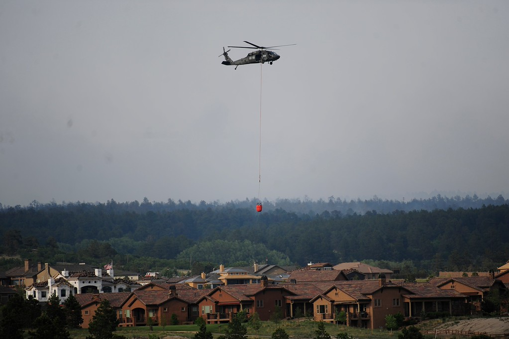 . COLORADO SPRINGS - JUNE 13: A helicopter refills with water over Flying Horse in Colorado Springs on Thursday, June 13, 2013. A mandatory evacuation has been called for the northern most subdivisions, north of North Gate Blvd. and East of Voyager Parkway due to the Black Forest Fire on June 13, 2013 in Colorado Springs(Photo By Grant Hindsley / The Denver Post)