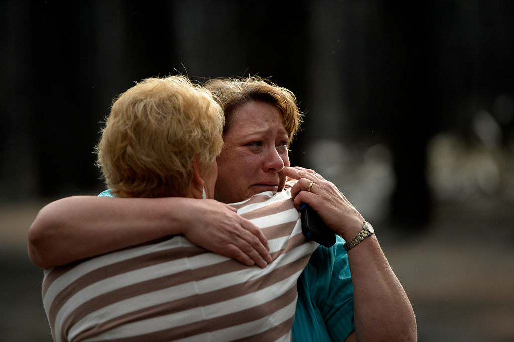 . COLORADO SPRINGS, CO. - June 18: Teresa Robertson wipes away her tears as she is hugged by a neighbor at her home that was totally taken by the fire as some residents were allowed back to see their homes that were burned in the Black Forest Fire area near Colorado Springs, Colorado. June 18, 2013 Denver, Colorado Springs. (Photo By Joe Amon/The Denver Post)