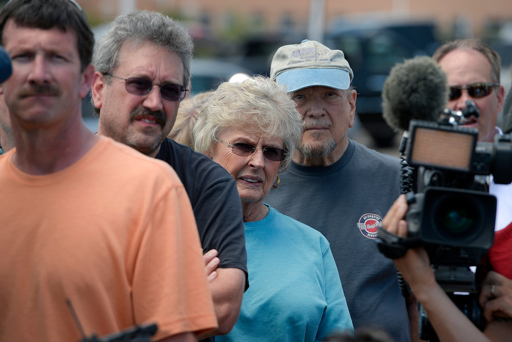 . Black Forest evacuees listen closely to a press briefing held for members of the media and for homeowners at Pikes Peak Community College Rampart Range Campus near Monument, CO  on June 15, 2013. Photo by Helen H. Richardson/The Denver Post)