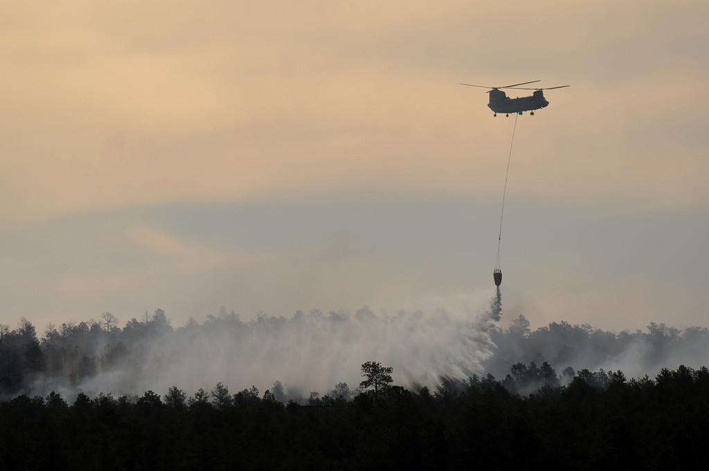 . COLORADO SPRINGS, CO. - June 12: A helicopter makes a water drop on the midst of the Black Forest Fire. Colorado Springs, Colorado. June 12, 2013. (Photo By Hyoung Chang/The Denver Post)