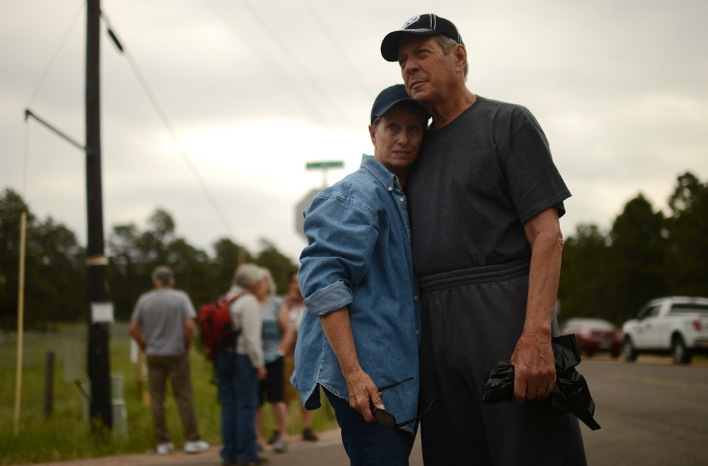 . Black Forest Fire evacuees Cindy Miller, left, and her husband Ray are waiting El Paso County Sheriff\'s escort to their property to pick up their truck at the corner of Vollmer Rd. and Burgess Rd., Friday, June 14, 2013. They lost house by the fire. Firefighters continue to battle the Black Forest fire north of Colorado Springs that has consumed 15,700 acres and 379 homes. (Photo By Hyoung Chang/The Denver Post)