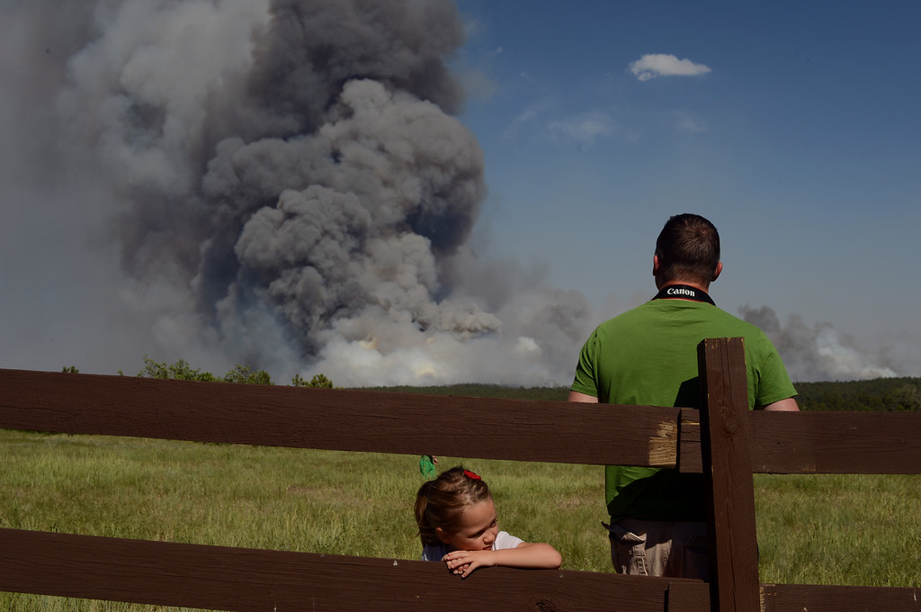 . Colorado Springs, CO. - June 11: Dyllan Kerr, 5, left, is watching the smoke covered BLack Forest area with her father Floyd. Colorado Springs, Colorado. June 11, 2013. The fire is about 15 acres near the 12600 block of Peregrine Way near Black Forest Regional Park. (Photo By Hyoung Chang/The Denver Post)