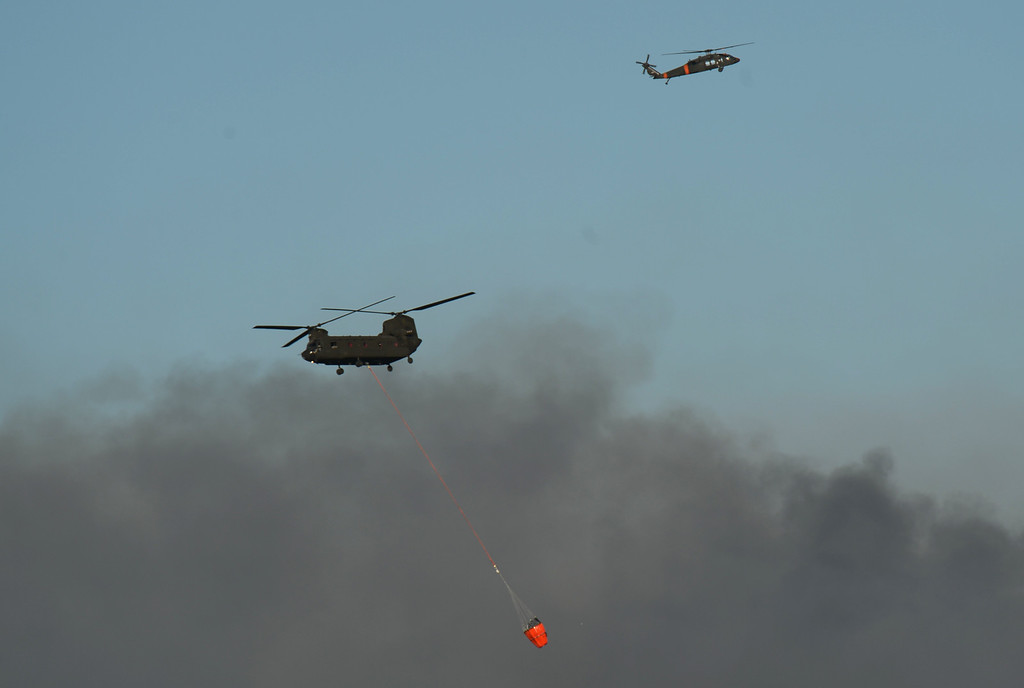 . Colorado Springs, CO. - June 11: Helicopters are heading to the smoke covered BLack Forest area. Colorado Springs, Colorado. June 11, 2013. The fire is about 15 acres near the 12600 block of Peregrine Way near Black Forest Regional Park. (Photo By Hyoung Chang/The Denver Post)