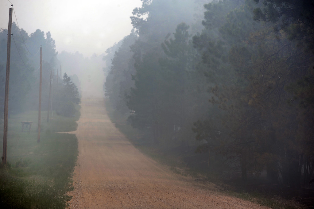 . BLACK FOREST, CO - JUNE 13:  Smoke clouds roads in the midst of the Black Forest Fire on June 13, 2013.  Photo by Helen H. Richardson/The Denver Post)