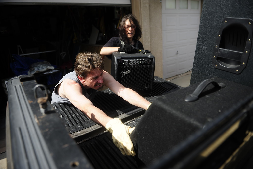. COLORADO SPRINGS - JUNE 13: Ron Vanackeren and M D\'Ziur move musical equipment out of Vanackeren\'s home while evacuating due to the Black Forest Fire on June 13, 2013. For the first time evacuations were issued within city limits of Colorado Springs. (Photo By Grant Hindsley / The Denver Post)