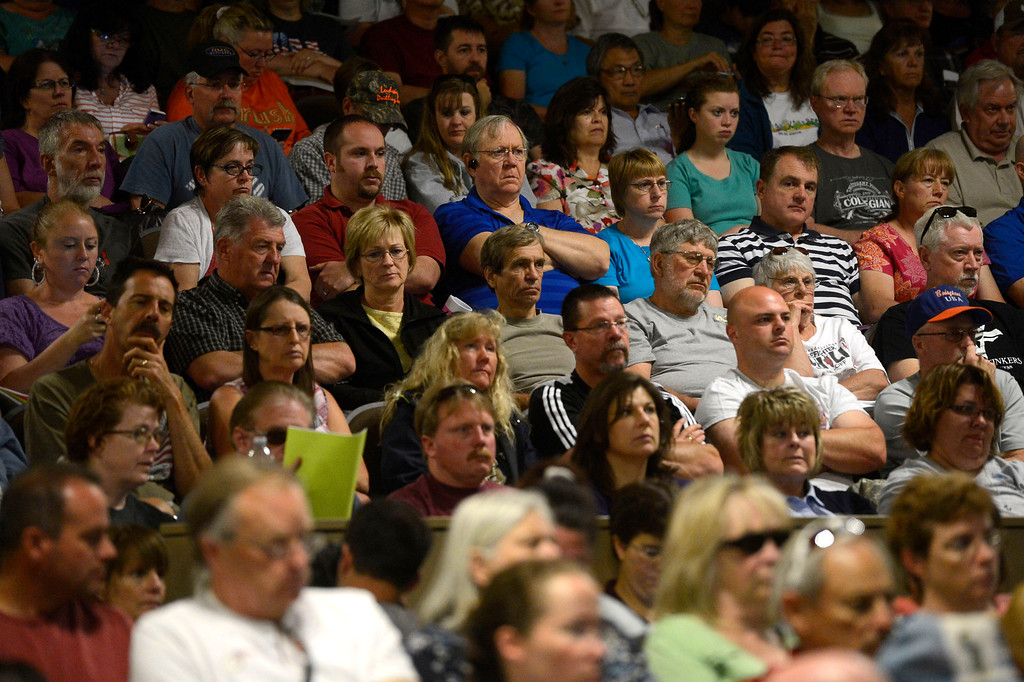 . Black Forest fire evacuees listen intently to officials at a community meeting for current updates on the fire at Palmer Ridge High School in Monument Colorado June 15, 2013. (Photo By Andy Cross/The Denver Post)