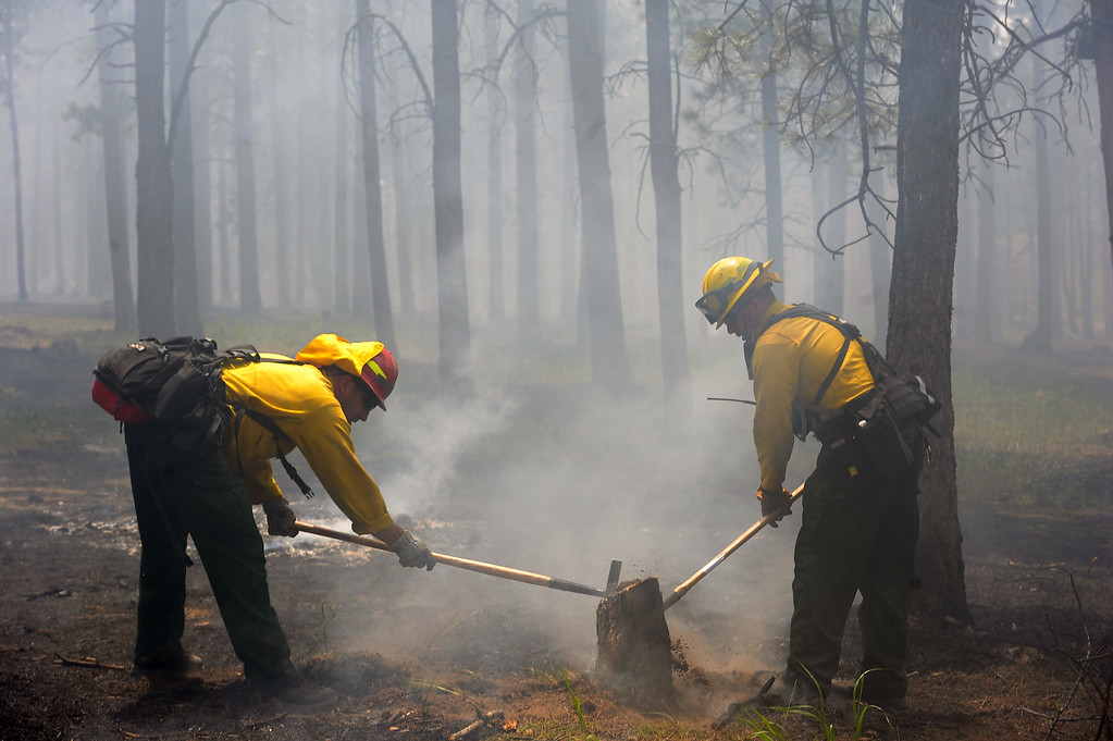 . National Guard Firefighters help fight fire along Remington Road north of  Hodgen Road in the midst of the Black Forest Fire on June 13, 2013.  Photo by Helen H. Richardson/The Denver Post)