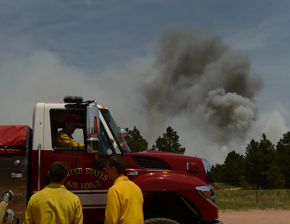 . COLORADO SPRINGS, CO. - June 13: Air Force Academy Firefighters secure the Black Forest section 16 trailhead. Colorado Springs, Colorado. June 13, 2013. The Black Forest fire has already destroyed at least 360 homes and consumed 15,000 acres. (Photo By Hyoung Chang/The Denver Post)