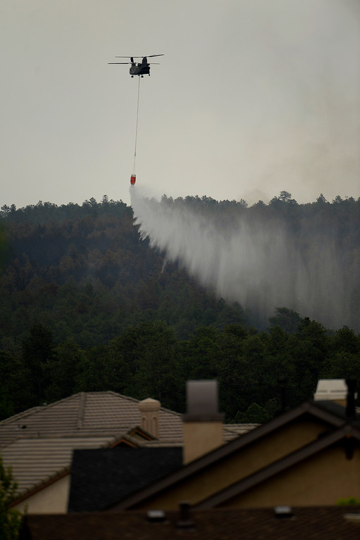 . COLORADO SPRINGS, CO. - June 14: A CH-47 Chinook drops water near the Flying Horse sub station at the Black Forest Fire area Colorado Springs, Colorado. June 14, 2013 Denver, Colorado Springs. (Photo By Joe Amon/The Denver Post)