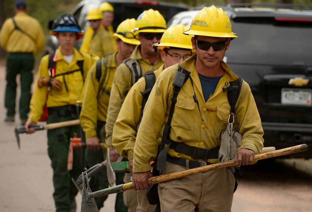 . BLACK FOREST, CO - JUNE 17:   James Gonzales of Wildfire Support Team from Santa Fe, New Mexico, takes his team to another home where the crew scours the properties for any kind of hotspots  inside of the Black Fire fire zone in Black Forest, CO on June 17, 2013.  The fire is now 75% contained and recent rains are helping firefighters. Photo by Helen H. Richardson/The Denver Post)