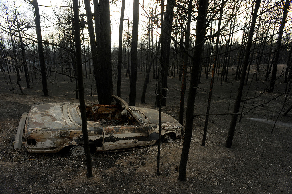 . BLACK FOREST, CO - JUNE 13:  A burned car and landscape show the scope of the loss in the midst of the Black Forest Fire on June 13, 2013.  Photo by Helen H. Richardson/The Denver Post)