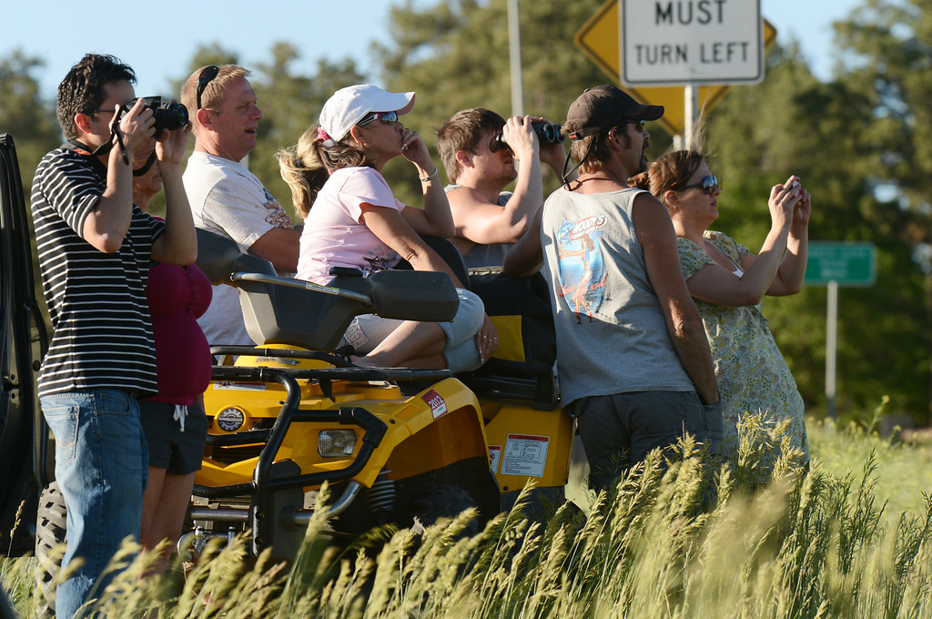 . Colorado Springs, CO. - June 11: People are watching the smoke covered BLack Forest area. Colorado Springs, Colorado. June 11, 2013. The fire is about 15 acres near the 12600 block of Peregrine Way near Black Forest Regional Park. (Photo By Hyoung Chang/The Denver Post)
