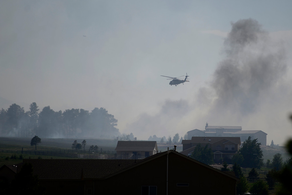 . COLORADO SPRINGS, CO - JUNE 12: A helicopter flies overhead near the north end of the Black Forest Fire east of Colorado Springs. (Photo by AAron Ontiveroz/The Denver Post)