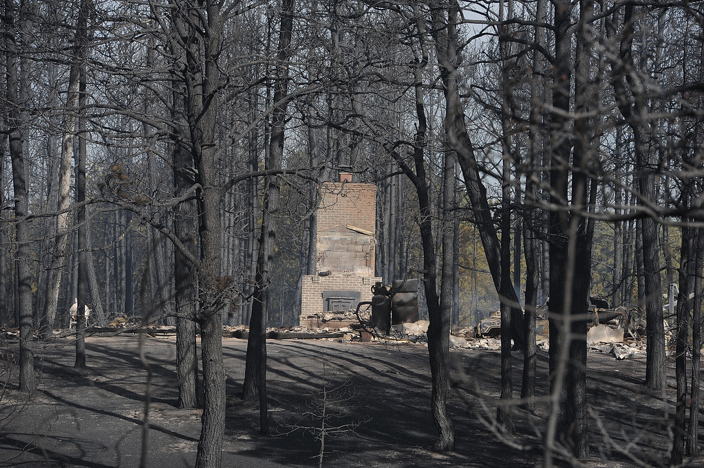 . COLORADO SPRINGS, CO - JUNE 12: Blackened and charred homes are seen along Herring Road in the Black Forest area northeast of Colorado Springs, CO on June 12, 2013. Temperatures are expected to be in the nineties again today.  Photo by Helen H. Richardson/The Denver Post)