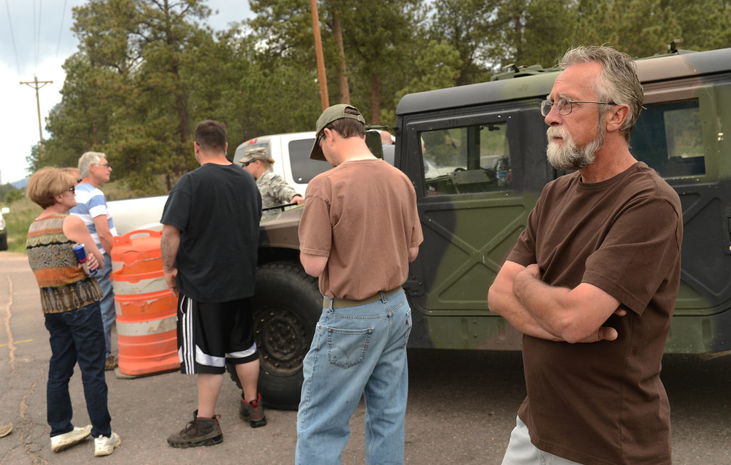 . Black Forest Fire evacuee Keith Steppe, right, is waiting for the El Paso County Sheriff\'s escort to his property for at the corner of Vollmer Rd. and Burgess Rd., Colorado Springs, Colorado, June 14, 2013.  (Photo By Hyoung Chang/The Denver Post)