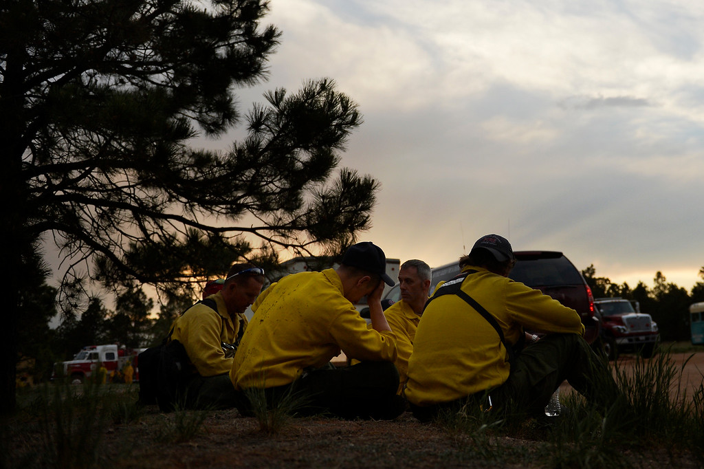 . COLORADO SPRINGS, CO. - June 13: Firefighters rest at Black Forest trail head section16 near the corner of Burgess Rd and Buckskin Ln along the edge of the Black Forest Fire Colorado Springs, Colorado. June 13, 2013 Denver, Colorado Springs. (Photo By Joe Amon/The Denver Post)