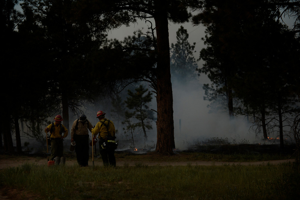. COLORADO SPRINGS, CO. - June 13: Firefighters refill their burn cans after back burning at Black Forest trail head section 16 near the corner of Burgess Rd and Buckskin Ln along the edge of the Black Forest Fire Colorado Springs, Colorado. June 13, 2013 Denver, Colorado Springs. (Photo By Joe Amon/The Denver Post)