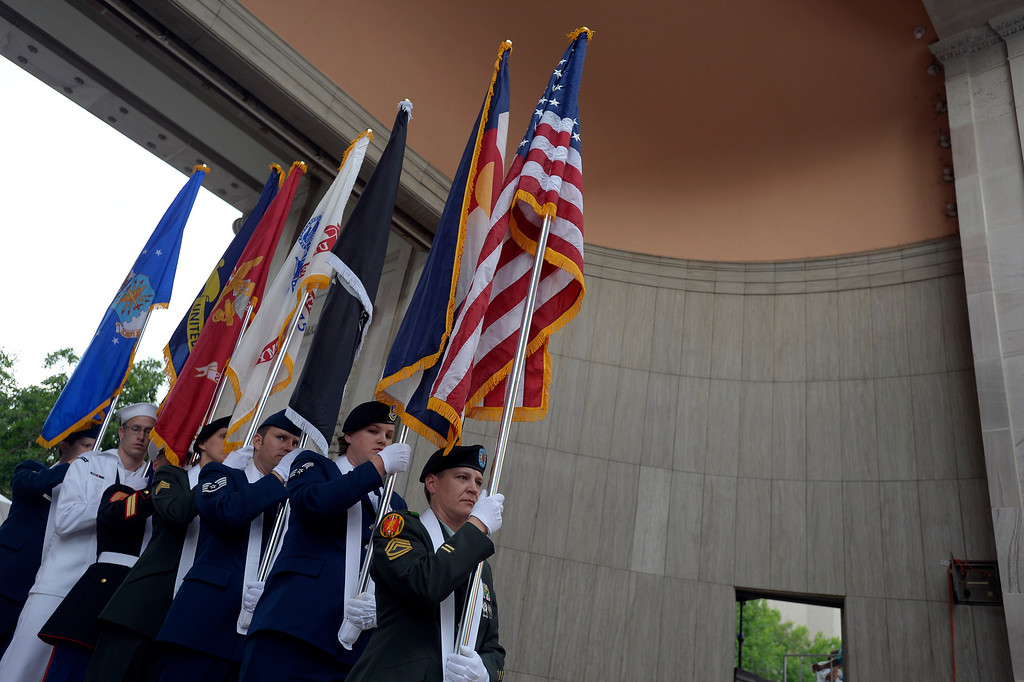 . DENVER, CO. - JUNE 16:  Luiza Fritz, Sgt. First Class Army with Amaerican Flag leads the color guard on stage to present the colors duirng the national anthem at the Civic Center Park June 16, 2013. The color guard this year will include gay vets and active service men and women -- wouldn\'t have happened five years ago. (Photo By John Leyba/The Denver Post)