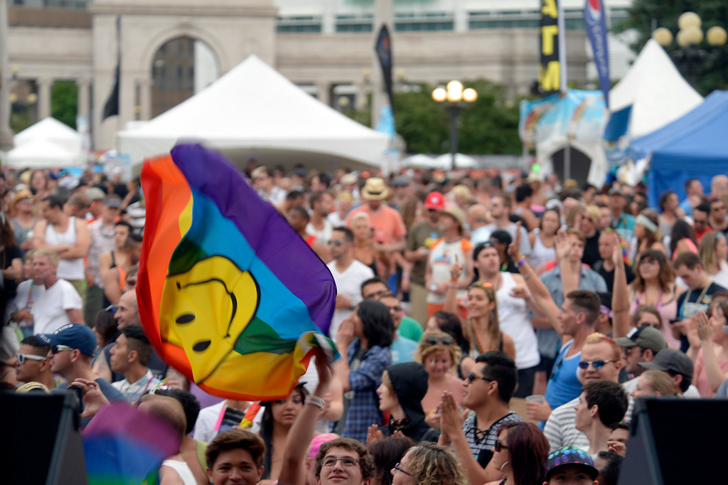 . DENVER, CO. - JUNE 16: Big crowd gathered at the main stage during Pridefest downtown Denver June 16, 2013. The color guard this year will include gay vets and active service men and women -- wouldn\'t have happened five years ago. (Photo By John Leyba/The Denver Post)