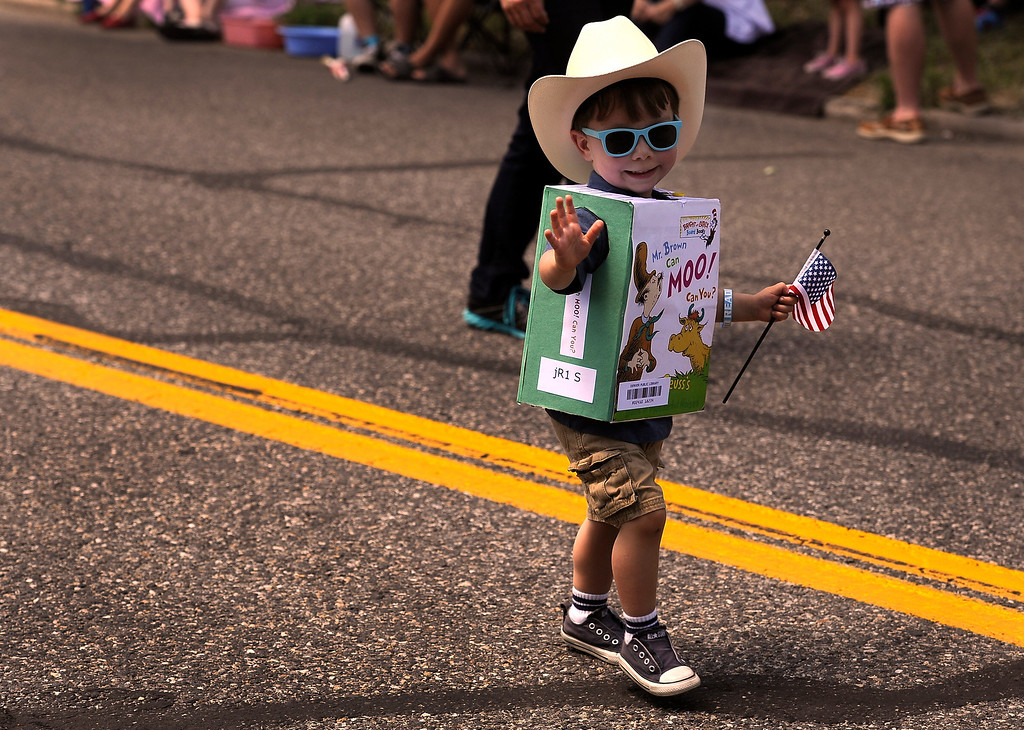 . DENVER, CO - JULY 4: Benjamin Vincent, 2, encourages everyone to read as he marches for the Park Hill Library as the fourth annual Park Hill 4th of July Parade winds its way down 23rd Avenue complete with marching bands, neighborhood sponsored floats, bikes and classic cars. (Photo By Kathryn Scott Osler/The Denver Post)