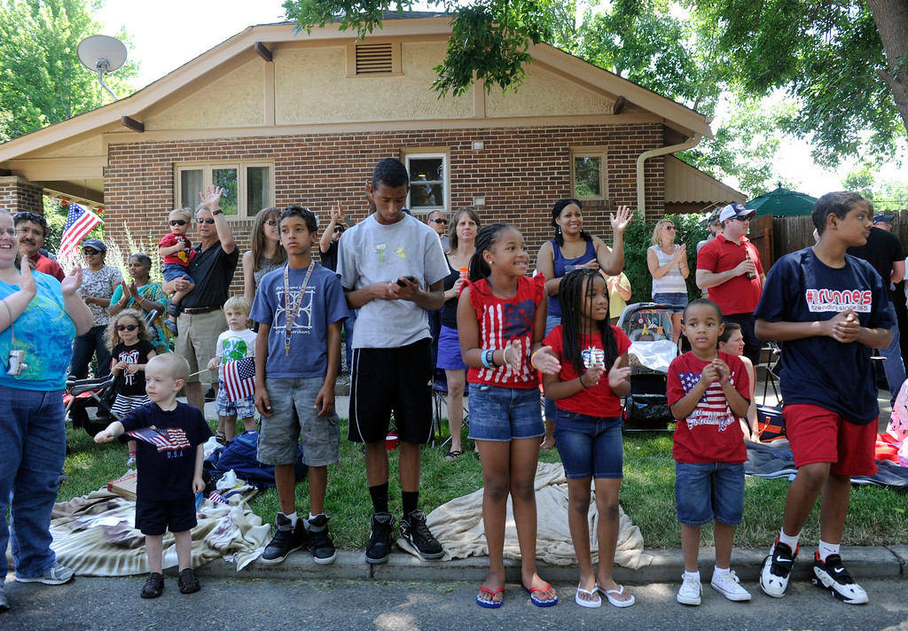 . DENVER, CO - JULY 4: Crowds gather to watch the fourth annual Park Hill 4th of July Parade as it winds its way down 23rd Avenue complete with marching bands, neighborhood sponsored floats, bikes and classic cars. (Photo By Kathryn Scott Osler/The Denver Post)