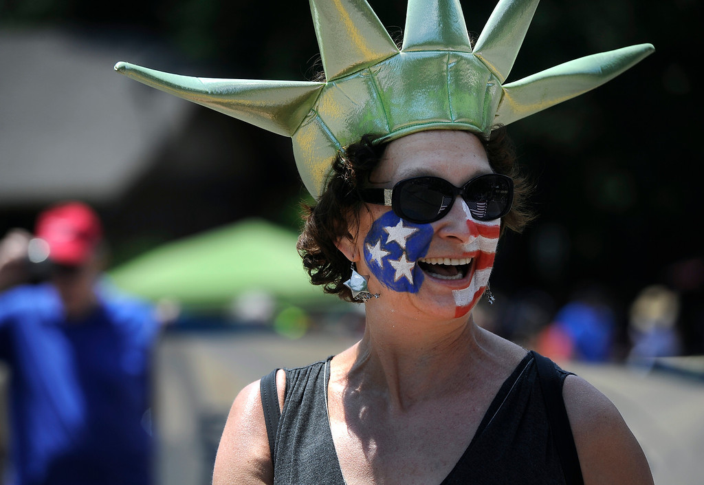 . DENVER, CO - JULY 4: Linda Drake came dressed as Lady Liberty as she marches in the fourth annual Park Hill 4th of July Parade as it winds its way down 23rd Avenue complete with marching bands, neighborhood sponsored floats, bikes and classic cars. (Photo By Kathryn Scott Osler/The Denver Post)