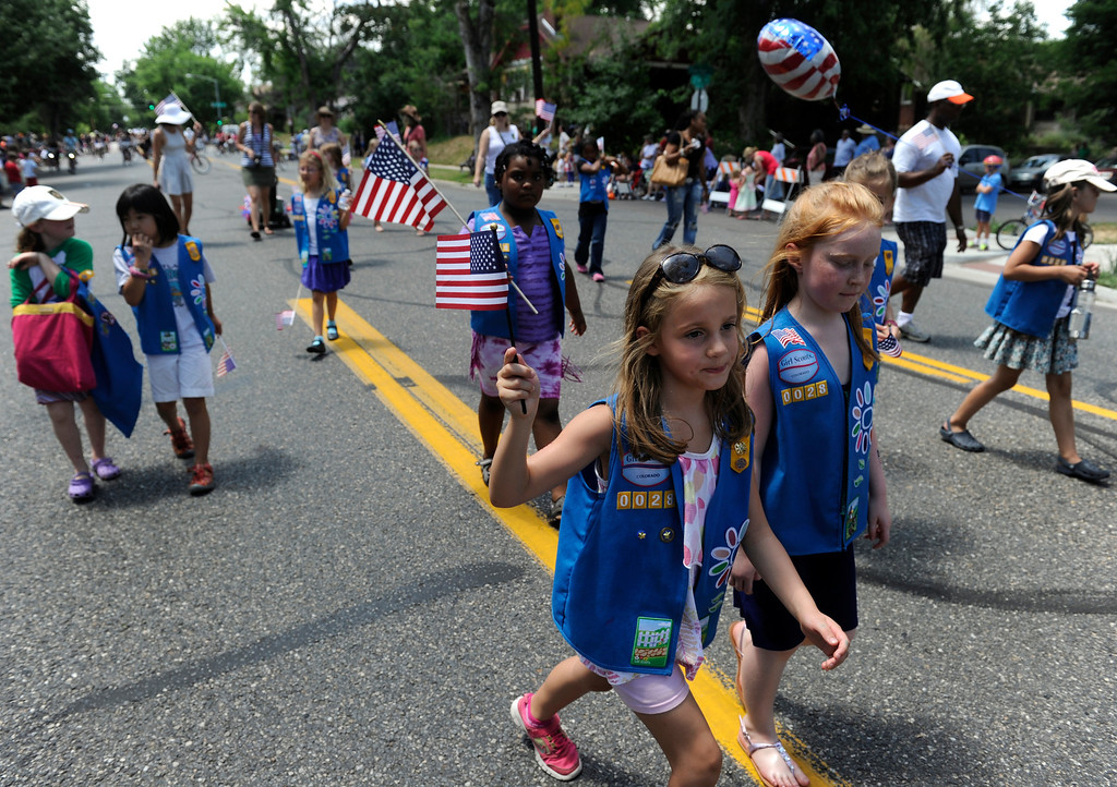 . DENVER, CO - JULY 4: Girl Scout troupe 28 wave flags and march past crowds gathered for the fourth annual Park Hill 4th of July Parade as it winds its way down 23rd Avenue complete with marching bands, neighborhood sponsored floats, bikes and classic cars. (Photo By Kathryn Scott Osler/The Denver Post)