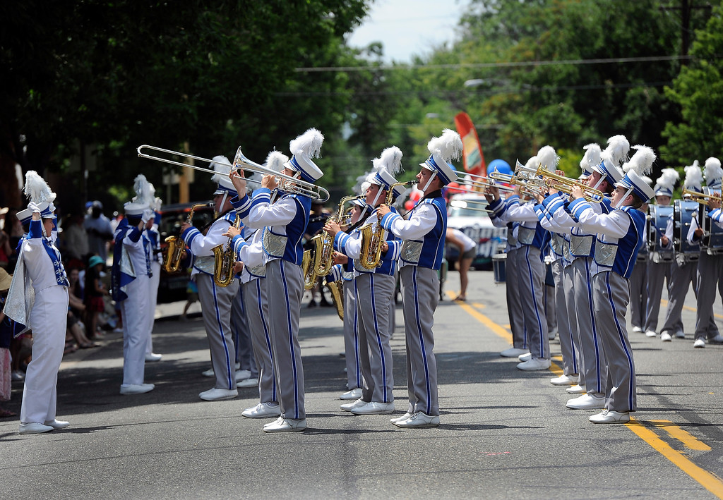 . DENVER, CO - JULY 4: The Cotter High School Marching Band from Winona, MN, pauses to play for the crowds gathered for the fourth annual Park Hill 4th of July Parade as it winds its way down 23rd Avenue complete with marching bands, neighborhood sponsored floats, bikes and classic cars. (Photo By Kathryn Scott Osler/The Denver Post)