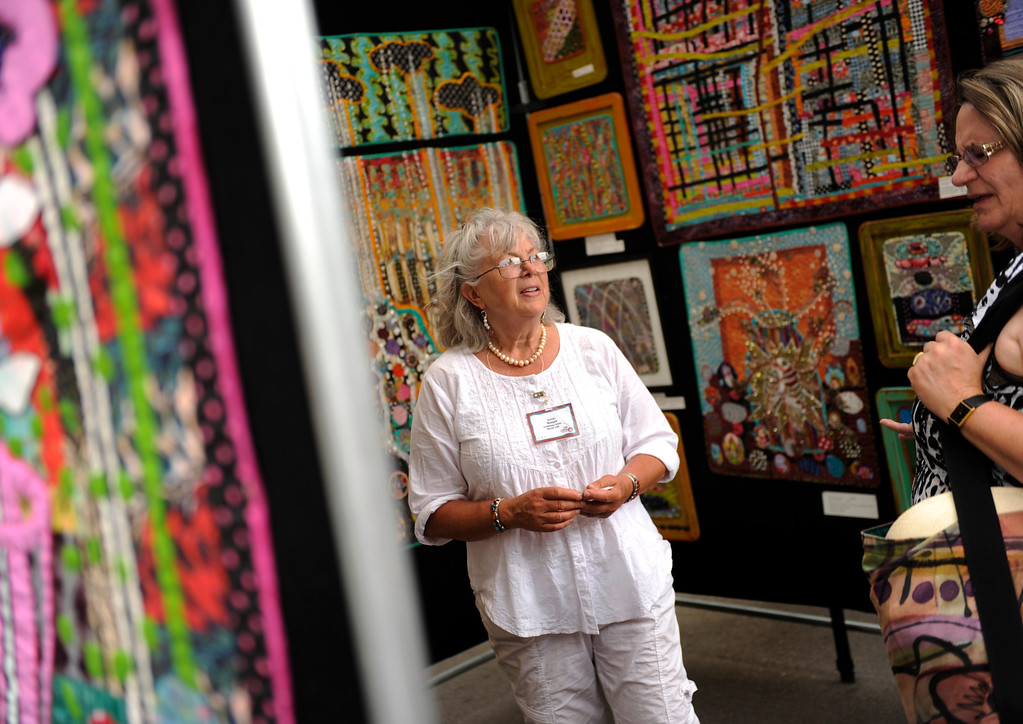 . DENVER, CO. - JULY 5:  Artist Terrie Hancock Mangat of El Prado, NM displayed a variety of hand-sewn art quilts at the Cherry Creek Arts Festival Friday. The annual festival opened for the weekend Friday afternoon, July 5, 2013, featuring 250 artists displaying their work. Photo By Karl Gehring/The Denver Post