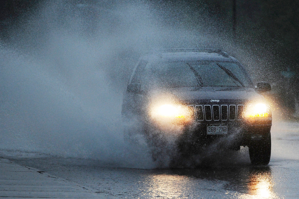 . DENVER, CO - JULY 13:  An SUV navigates standing water along Colorado Blvd near Cornell Ave during a heavy rainstorm Saturday evening, July 13, 2013. (Photo By Andy Cross/The Denver Post)