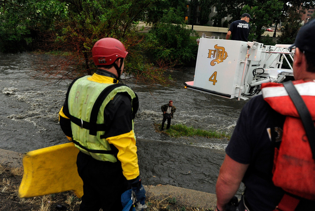 . DENVER, CO. - JULY 13:  Homeless man Tom Pascarelli was rescued by Denver Firefighters after rising water in Cherry Creek trapped him on an island near Broadway and Speer Saturday. Hard rains across the Denver metro area led to localized flooding Saturday evening, July 13, 2013.  Pascarelli said he had hoped to sleep under a bridge Saturday night. Photo By Karl Gehring/The Denver Post
