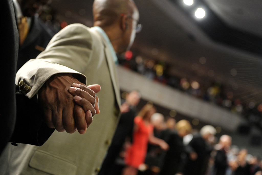 . DENVER, CO. - JULY 17:  The congregation held hands as they prayed for the victims of the Aurora theater shooting last year during a service Wednesday night. Bishop TD Jakes preached at the Potters House Church of Denver, 9495 E. Florida Avenue in Denver, Wednesday evening, July 17, 2013.  Photo By Karl Gehring/The Denver Post
