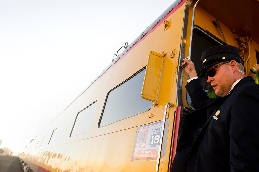 . DENVER, CO - JULY 20: A train conductor steps off steam locomotive No. 844 before the all aboard on Track 20 at the Denver Train Yard during Denver Post Cheyenne Frontier Days on July 20, 2013, in Denver, Colorado. The train travels to and from Cheyenne, Wyoming. (Photo by Daniel Petty/The Denver Post)