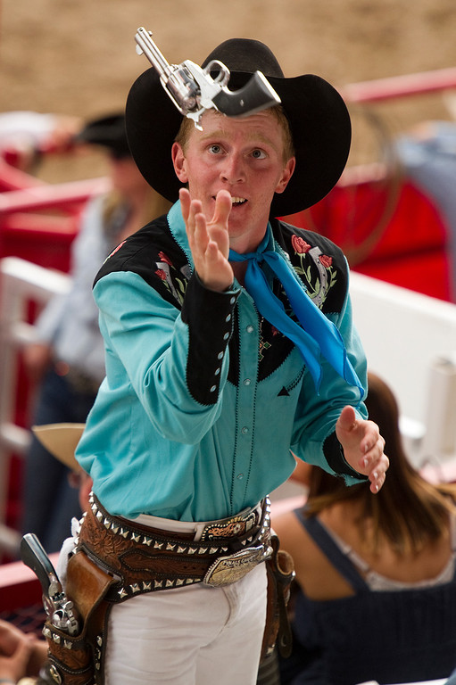 . CHEYENNE, WY - JULY 20: A performer tosses pistols in the air in front of the crowd attending the rodeo at Cheyenne Frontier Days on July 20, 2013, in Cheyenne, Wyoming. (Photo by Daniel Petty/The Denver Post)