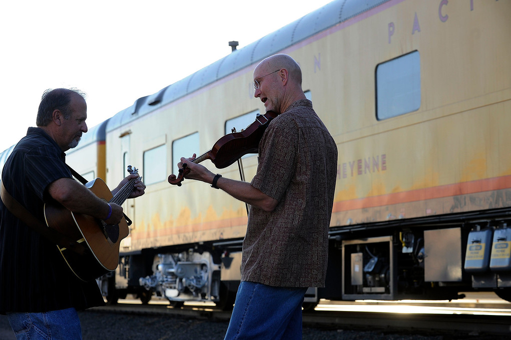 . DENVER, CO - JULY 20: Jerry Magnetti, left, and Gordon Burt, of Southern Exposure, play a tune beside the Denver Post Cheyenne Frontier Days Train before its departure on July 20, 2013, in Denver, Colorado. (Photo by Anya Semenoff/The Denver Post)
