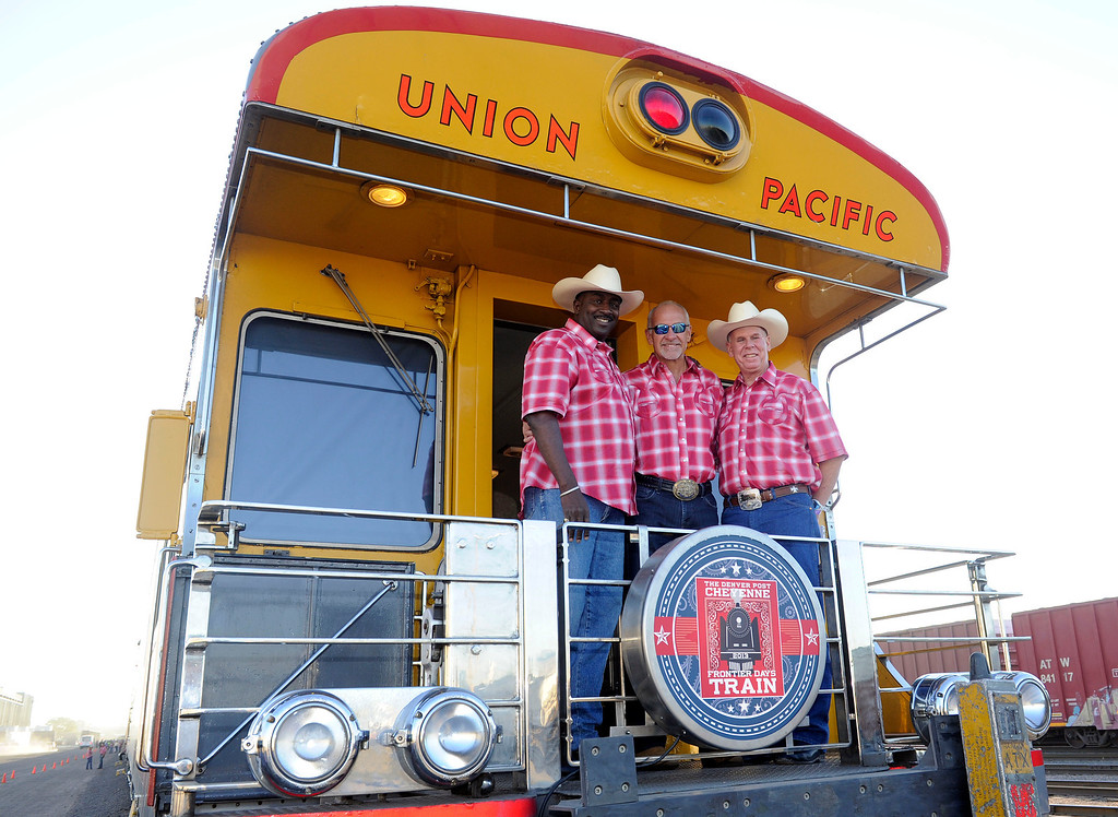 . DENVER, CO - JULY 20: Greg Moore, Mac Tully, and  Kirk MacDonald pose for a portrait before the Denver Post Cheyenne Frontier Days Train departs for Cheyenne, Wyoming, on July 20, 2013, in Denver, Colorado. (Photo by Anya Semenoff/The Denver Post)