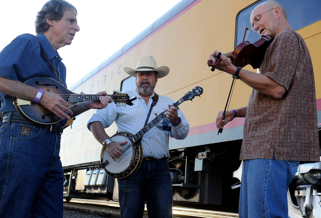. DENVER, CO - JULY 20: Mike Jagel, center, plays a tune with Jerry Mills, left, and Gordon Burt, before the departure of the Denver Post Cheyenne Frontier Days Train on July 20, 2013, in Denver, Colorado. (Photo by Anya Semenoff/The Denver Post)