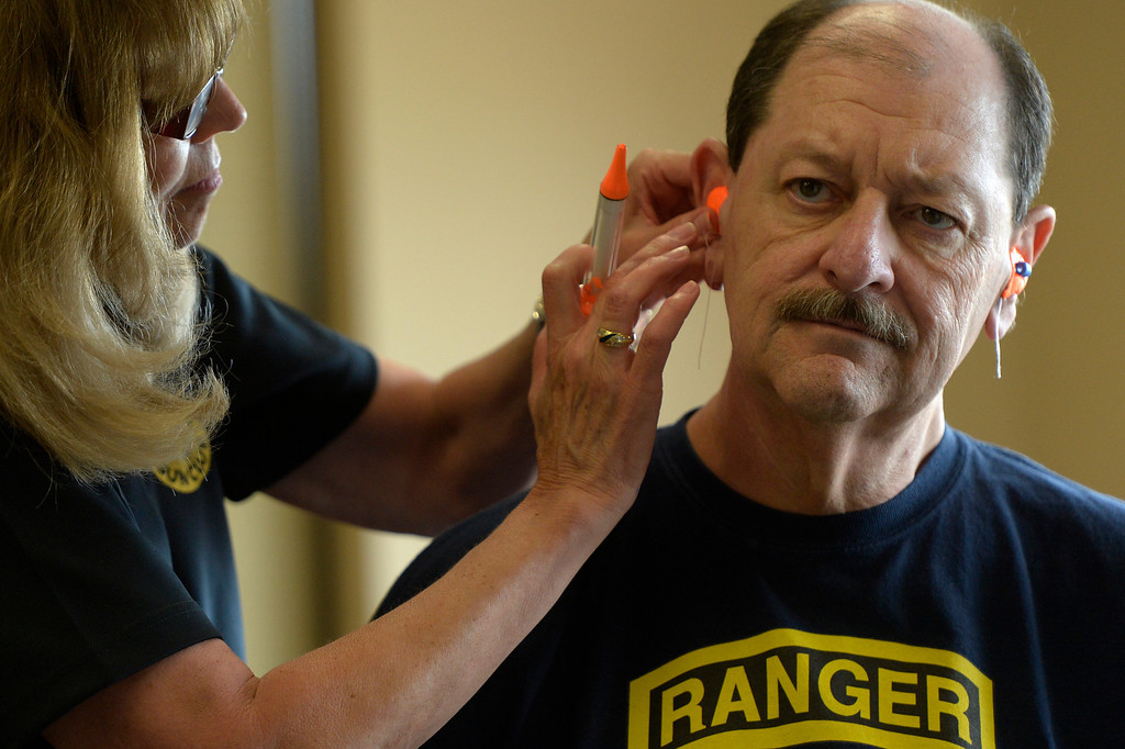 ". CENTENNIAL, CO. - JULY 27: Mary Abramson makes custom molded hearing protection for Wayne Yakes during a Multi-State Concealed Carry class at the Centennial Gun Club Training Center in Centennial, CO, July 27, 2013. The number of people seeking a concealed carry gun permit in Colorado has increased by 87 percent from last year.Yakes says he is taking the class because, :I\'m afraid they\'ll deny concealed carry permits soon, if they pass idiot laws like limitting gun magazines. It\'s a slippery slope... I\'ve never bought a gum in my life and I\'m ex-military. Now I\'ve bought guns.""  (Photo By Craig F. Walker / The Denver Post)"