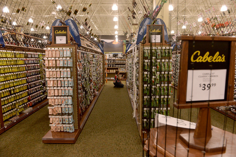 . Brandi Rail, an employee of Cabela\'s working in the fishing department, helps set up the new store in Thornton, July 30, 2013. Cabela\'s held a media preview in advance of the opening of its two new stores in Thornton and Lone Tree on August 15. (Photo By RJ Sangosti/The Denver Post)