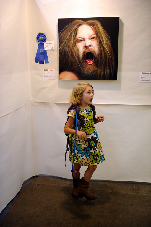 . DENVER, CO. - AUGUST 10: Mary Lukavic, age 5, reacted to a piece of art by Marie Vlasic at the Denver County Fair Saturday afternoon, August 10, 2013. Photo By Karl Gehring/The Denver Post