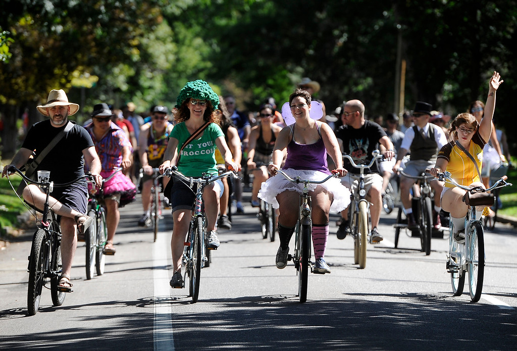 . DENVER, CO - Sept. 7: Thousands of cyclists join in the Tour de Fat costumed bicycle parade and festival around City Park and east down 17th Avenue. After the parade the festival includes entertainment, food, as well as New Belgium Beer with the beer and merchandise sales going directly to BikeDenver. (Photo By Kathryn Scott Osler/The Denver Post)