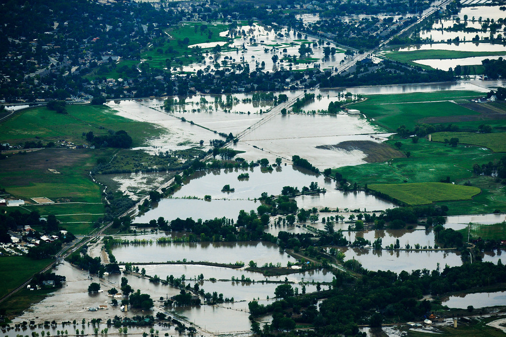 . An aerial photograph looking east form Lyons shows the damage from the flood, September 13, 2013. Massive flooding continues to hit Colorado. (Photo By RJ Sangosti/The Denver Post)
