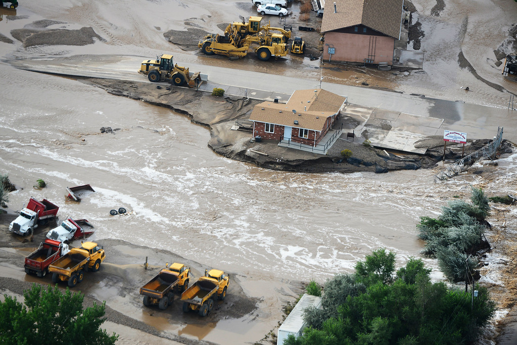 . Flood waters continue to flow right through Jake Kauffman and Son, a landscaping materials business in Loveland Colorado Saturday morning, September 14, 2013. (Photo By Andy Cross/The Denver Post)