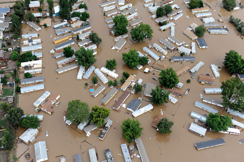 . Flood water in a trailer park off of 37th street in Evans Colorado, carrying belongings recovered from flooded  homes in the area. Aerial photographs of the Platte River flooding cities and farms in Weld County Colorado. (Photo By Tim Rasmussen/The Denver Post)