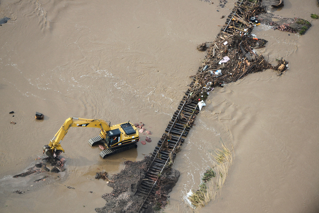 . Crews work to clear debris from flooded railroad tracks in Loveland Colorado Saturday morning, September 14, 2013. (Photo By Andy Cross/The Denver Post)